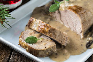 Delicious roast pork fillet with mushroom sauce