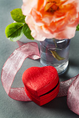 Heart shaped gift box and rose in vase, Valentine's Day concept