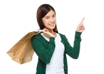 Woman with shopping bag and finger point up