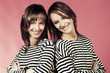 Two young fashion girls in a striped shirts