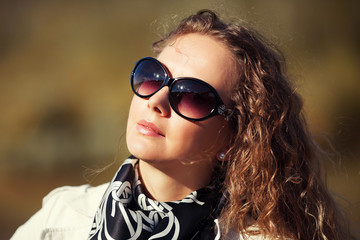 Beautiful fashion woman in sunglasses outdoor