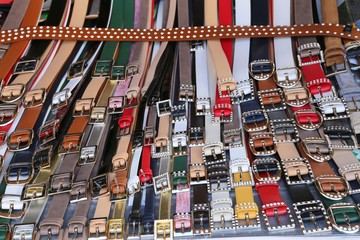 many men's leather belts and shoes for sale at flea market