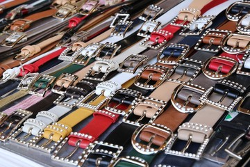 many men's leather belts and shoes for sale