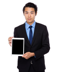 Businessman show the blank screen of tablet