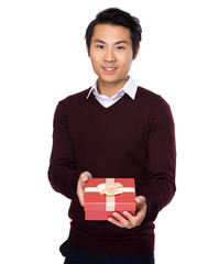 Asian man hold with red gift box