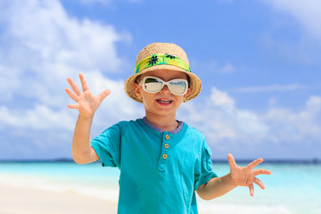 little boy having fun on beach vacation