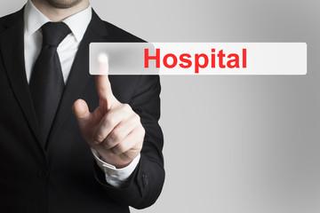 businessman pushing flat button hospital