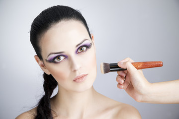 Professional makeup and hairstyle beautiful young woman close up