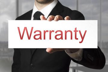 businessman holding sign warranty