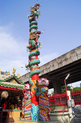 Dragons around a pole in Bangkok of Thailand