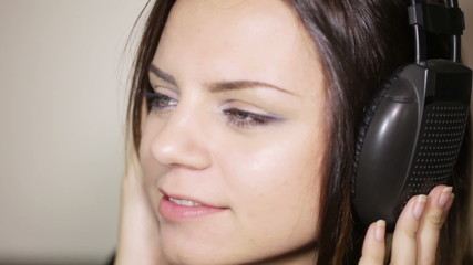 Girl in headphones smile