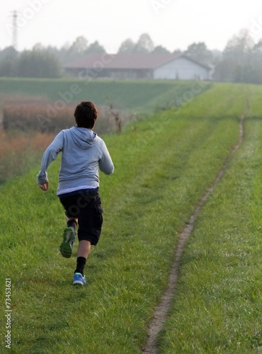 Poster child runs along a country road