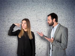 Businesswoman making a crazy gesture over textured background