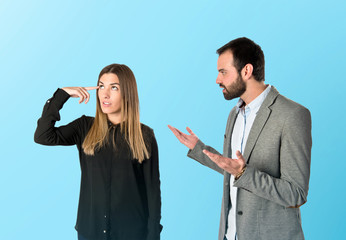 Businesswoman making a crazy gesture over blue background