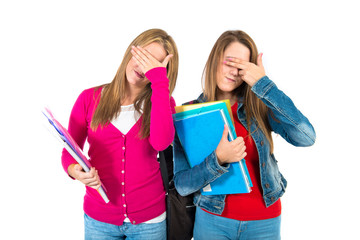 Student women covering her eyes over white background