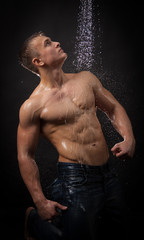 Muscular man under the shower