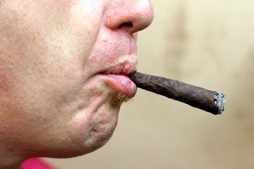 smoker with big cigar in his mouth