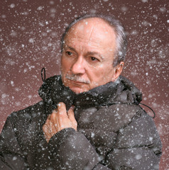 Portrait of a senior man in winter clothing