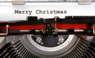 MERRY CHRISTMAS written with black ink with the typewriter