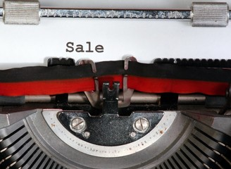 sale written with ink with the typewriter
