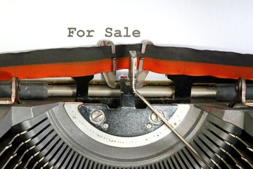 sale written with black ink with the old typewriter