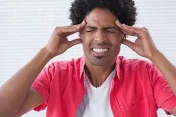 Stressed businessman getting a headache