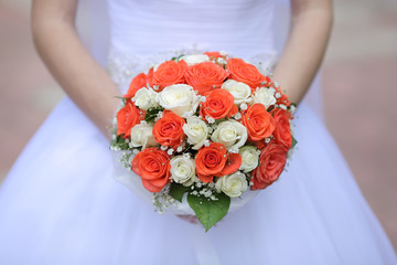 wedding bouquet of white and orange rose
