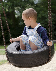 Child on swing at playground