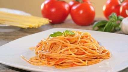 spaghetti with parmesan cheese and tomato sauce