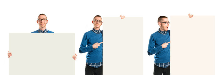 Redhead man holding an empty cardboard over white background