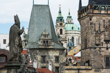 Saint Nicholas church and town bridge tower in Prague