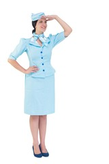 Pretty air hostess with hand on hip