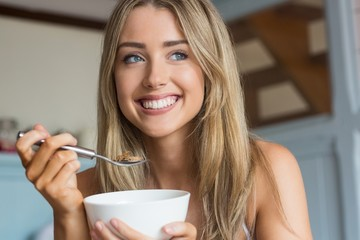 Cute blonde having cereal for breakfast
