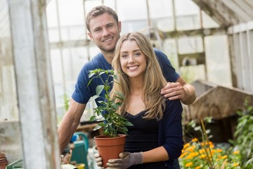 Cute couple gardening in greenhouse