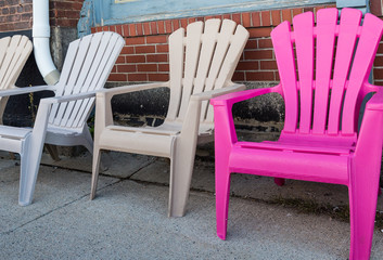 One Pink Chair with Three White Ones