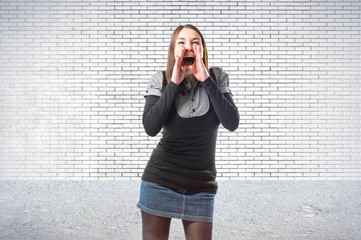 Young girl shouting over textured background