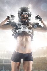 American football female player is posing