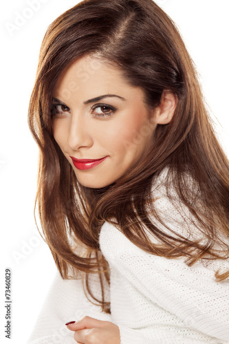 canvas print picture Beautiful young woman in white sweater