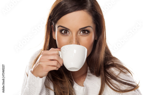 canvas print picture Beautiful young woman enjoying a morning coffee
