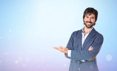 Businessman presenting something over blue background