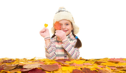 girl with autumn leaves on white
