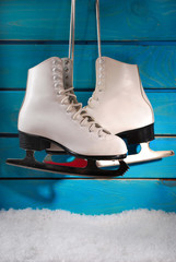 ice skates on blue wooden background
