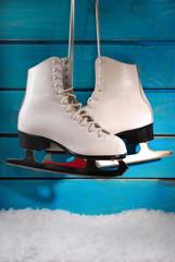 ice skates on blue wooden background