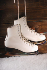ice skates on wooden background