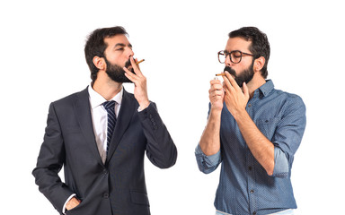 Man smoking with his brother over white background
