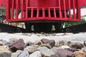 Red bumper of diesel train on railway