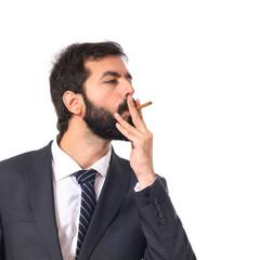 Businessman smoking over isolated white background