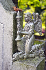 angel with candlestick in old cemetery