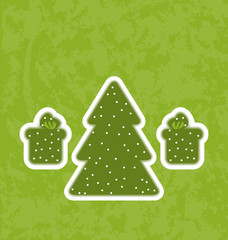 Green paper cut-out christmas tree fnd gifts