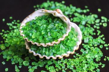 Green bath salt in a seashells